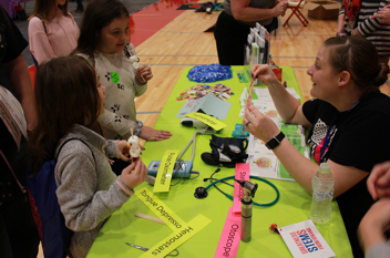 Young Iowans try out health diagnostic tools brought by Guthrie County Hospital to a recent Southwest Regional STEM Festival.