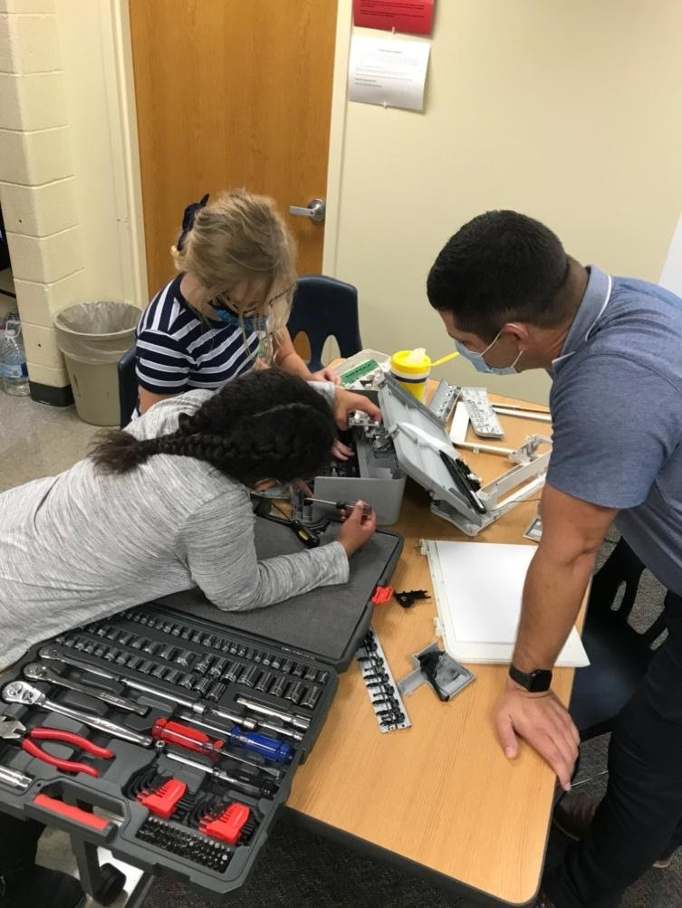 Two students and a teacher participating in STEM Best education at their school.