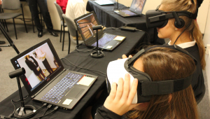 Assumption High School students experiencing virtual reality made possible by the STEM Best award.