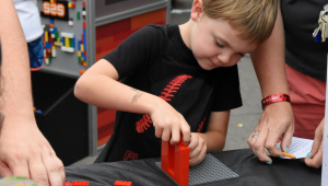 Child interacts with STEM Day at the Fair exhibit