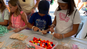 Children participate in a hands-on STEM activity at the State Fair.