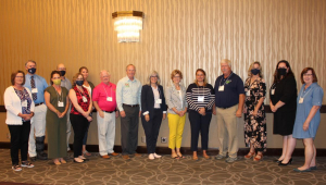 Group picture of sixteen STEM leaders from across the Midwest who met in Des Moines.