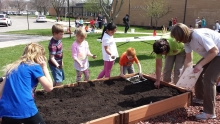 """Hiawatha Elementary students plant raised beds as a part the """"Agriculture in the Classroom"""" program"""