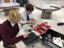 High school students from Saint Albert Catholic Schools, a STEM BEST Program model, code with robotics.